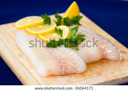 Raw fish fillet with punch - stock photo