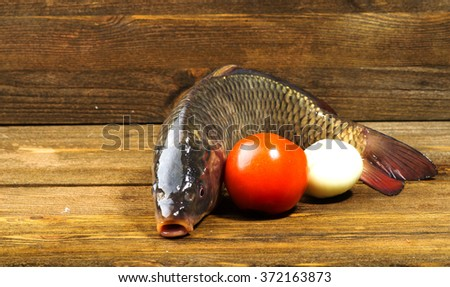 raw fish on wooden table as background . - stock photo