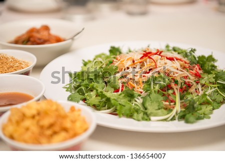 Raw fish salad (also known as Yu Sheng or Lo Hei), a Chinese New - stock photo