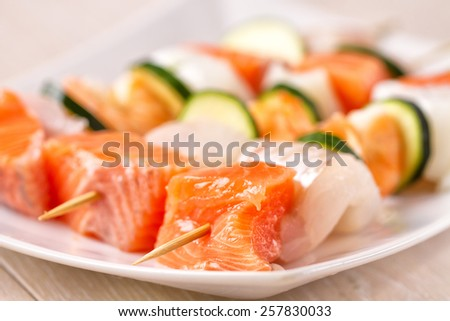Raw Fish skewers - stock photo