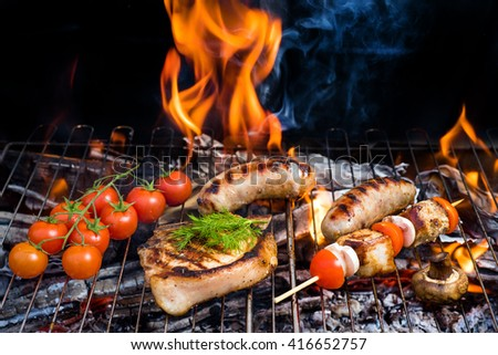 Raw Fresh Bloody Strip Steak, Tomatoes And Mushrooms On Hot Grill. Flames Of Fire On The Background - stock photo