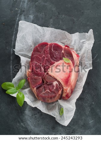 Raw fresh meat on paper, selective focus - stock photo