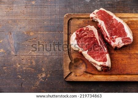 Raw fresh meat Ribeye Steak on dark background - stock photo