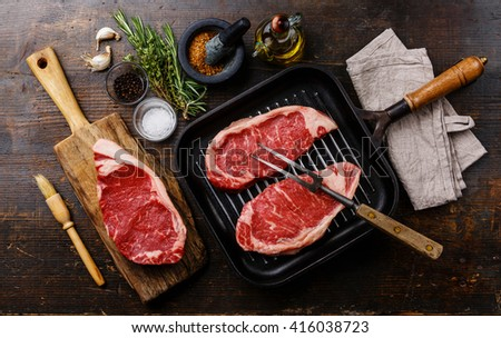 Raw fresh meat Steak Striploin with ingredients and frying Grill pan - stock photo
