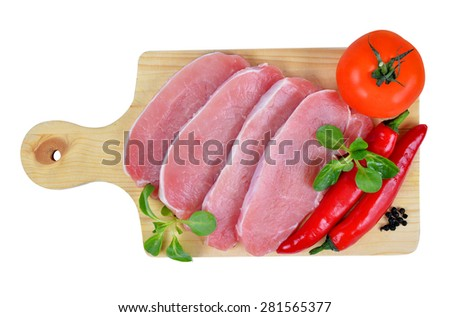 Raw fresh meat with chilli peppers and tomato on board on white background - stock photo