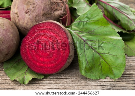 raw fresh organic beets with green leaves - stock photo