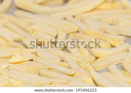Raw frozen french fries - stock photo