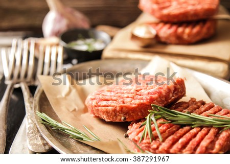 Raw Ground beef meat Burger steak cutlets on  wooden background - stock photo