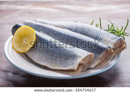 raw herrings fillets - stock photo