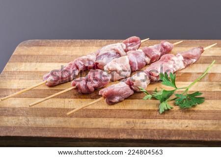Raw lamb cow pork skewer - stock photo