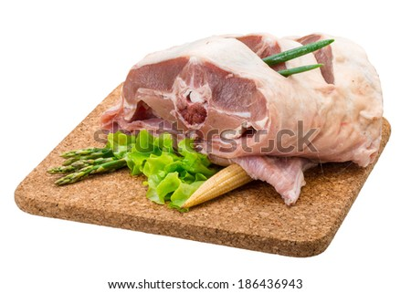 Raw lamb with asparagus - stock photo