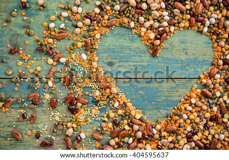 Raw legume heart on old rustic wooden table, close-up. - stock photo