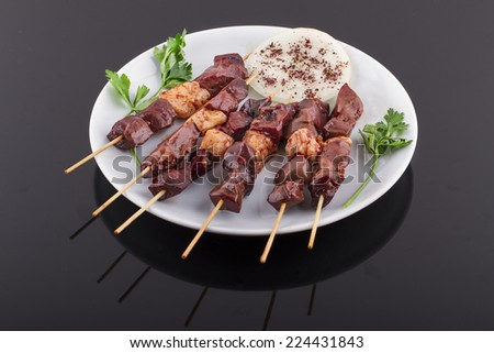Raw Liver Kebab on a Plate - stock photo