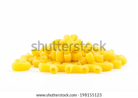 Raw macaroni on white background. - stock photo