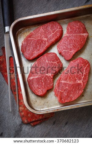 Raw marbled beef steak - stock photo