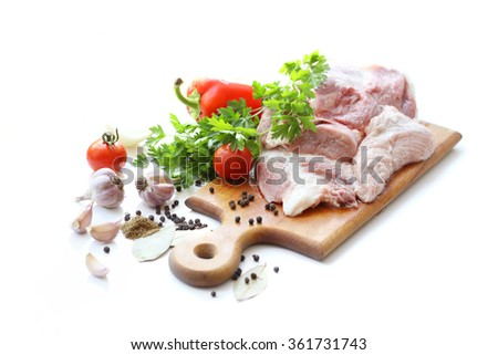 raw meat and different spices on wooden cutting board - stock photo