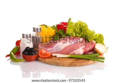 Raw meat and vegetables on a wooden board isolated on whit? - stock photo