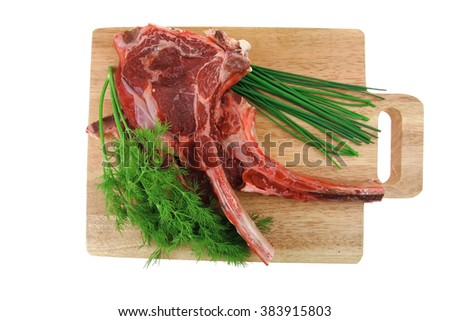 raw meat : boned fresh ribs served with dill and green chives on wooden board isolated over white background - stock photo
