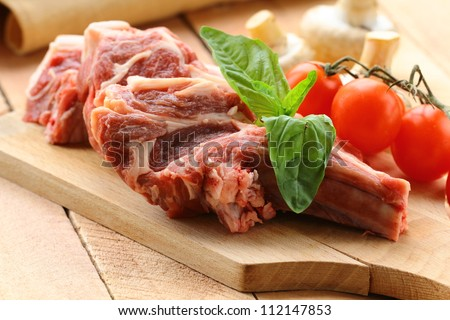 raw meat, lamb chops with vegetables - stock photo