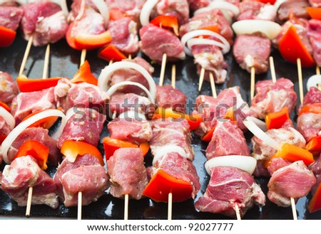 Raw meat on wooden sticks - stock photo