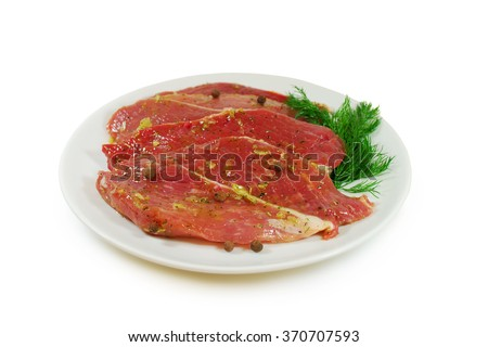 Raw meat. Pork escalope with sauce Isolated Against White Background - stock photo