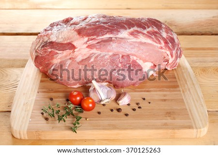 Raw meat pork neck boneless on a wooden board - stock photo
