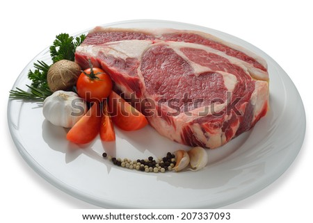 Raw meat ready to be cooked isolated on white background  ( rib eye steak ) - stock photo