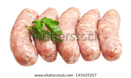 Raw meat sausages with greens isolated on white background - stock photo