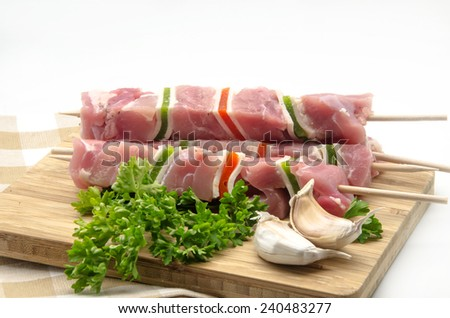 Raw meat skewer with red and green peppers - stock photo