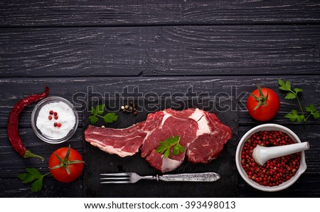 Raw meat steak entrecote. Selective focus, top view, space for text - stock photo
