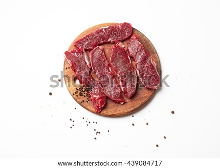 Raw Meat Steaks and Spices on the wooden board - stock photo