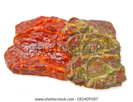 raw meat steaks in the marinade for grilling - stock photo