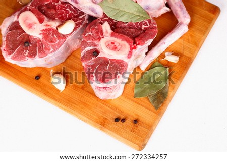 raw meat with spices on a cutting board - stock photo