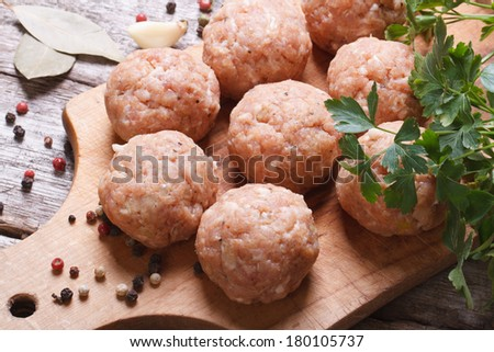 raw meatballs on a chopping board and ingredients. view from above. macro   - stock photo