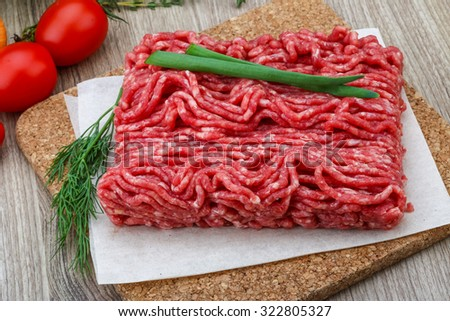 Raw minced beef meat with green oinion and dill - stock photo