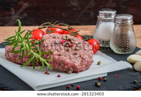 Raw Minced Hamburger Meat with Herb and Spice Prepared for Grilling - stock photo