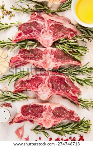 Raw  mutton meat, lamb loin chops with fresh herbs and oil, top view, close up - stock photo