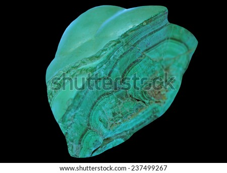Raw , no polished malachite from Congo  isolated on a black background - stock photo