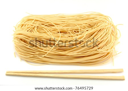 Raw noodle and a chopstick - stock photo