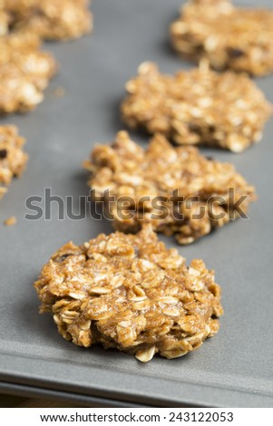 Raw oatmeal cookies on baking sheet, ready for cooking - stock photo