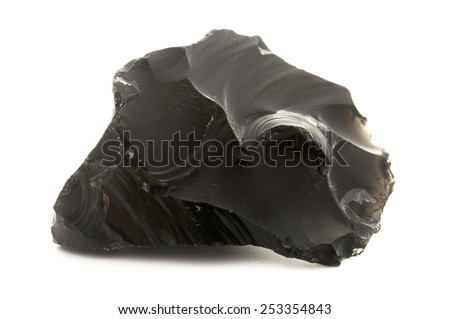 Raw obsidian on a white background - stock photo
