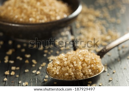 Raw Organic Cane Sugar in a Bowl - stock photo