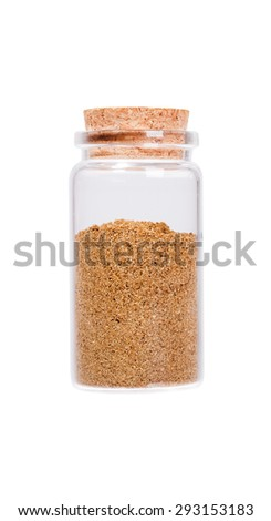 Raw organic coriander spice powder in a glass bottle with cork stopper, isolated on white. - stock photo