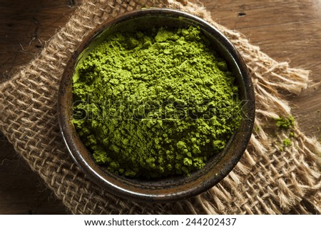 Raw Organic Green Matcha Tea in a Bowl - stock photo