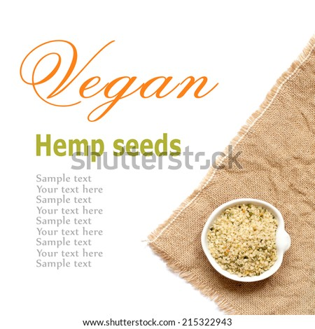 Raw Organic hemp seeds in a bowl on a white background - stock photo