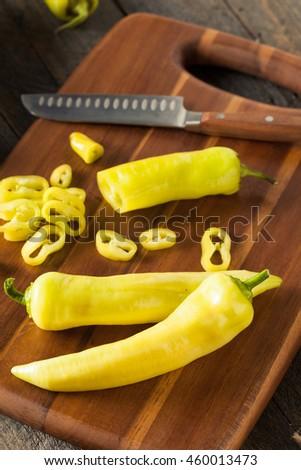 Raw Organic Yellow Banana Peppers Ready to Cut - stock photo