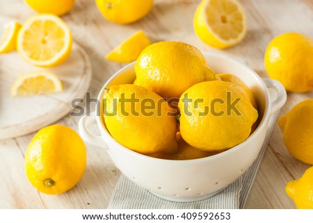 Raw Organic Yellow Lemons Citrus Ready to Use - stock photo