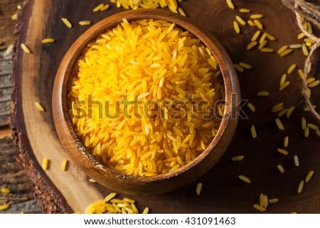Raw Organic Yellow Saffron Rice in a Bowl - stock photo