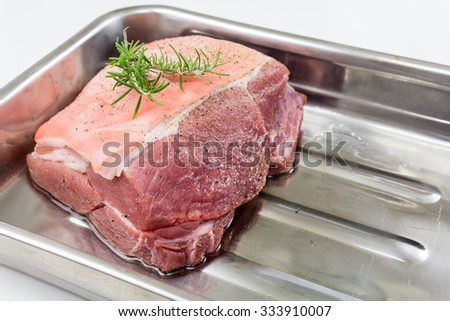 Raw pork at a time - the roast pork with crackling - stock photo