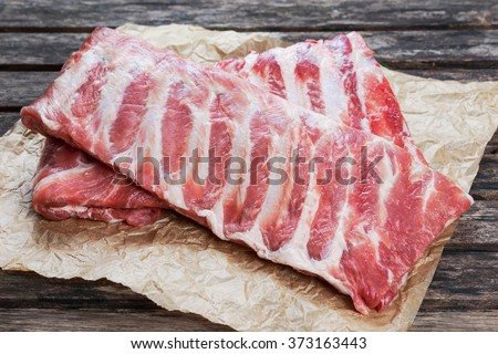 Raw Pork ribs. on crumpled paper - stock photo